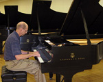 Jerry Gowen in the Steinway selection room.